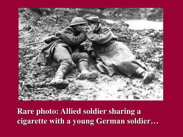 Rare photo: Allied soldier sharing a cigarette with a young German soldier…