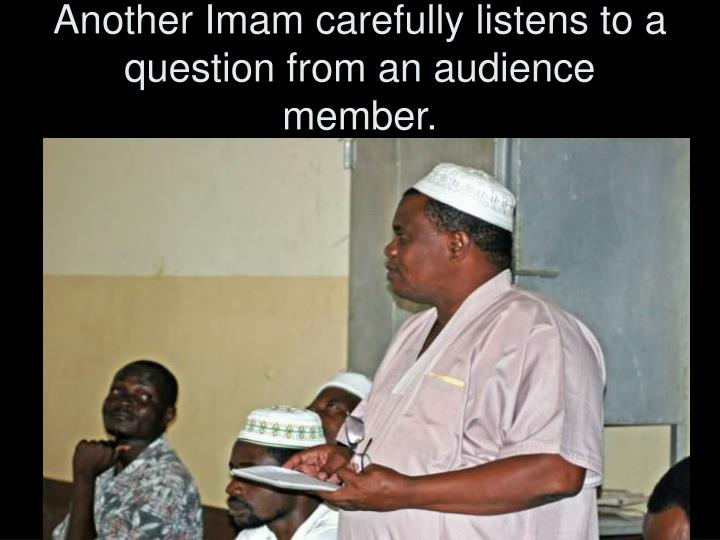 Another Imam carefully listens to a question from an audience member.