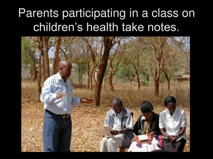 Parents participating in a class on children's health take notes.