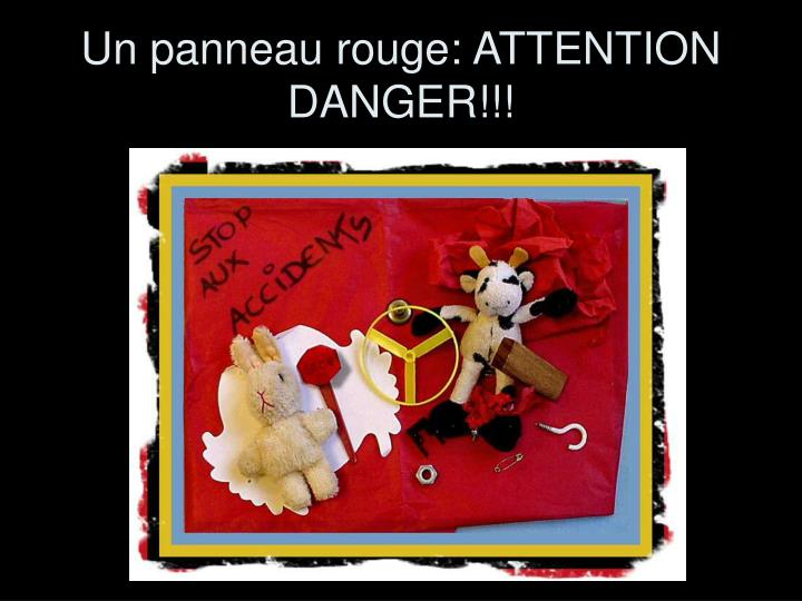 Un panneau rouge: ATTENTION  DANGER!!!