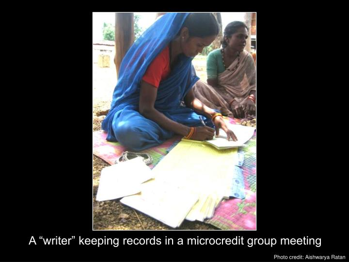 "A ""writer"" keeping records in a microcredit group meeting"
