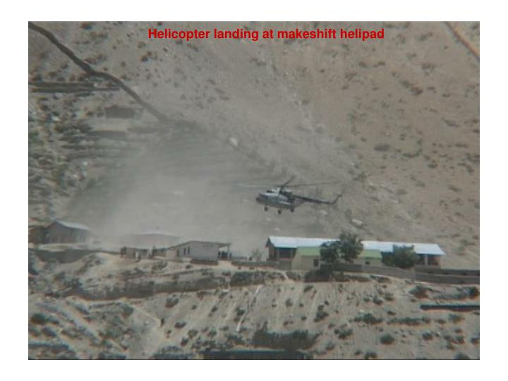 Helicopter landing at makeshift helipad
