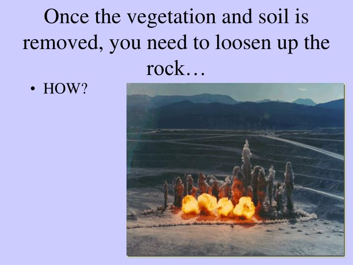 Once the vegetation and soil is removed, you need to loosen up the rock…