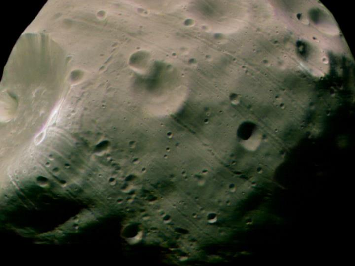 Why Are There Grooves on Phobos?