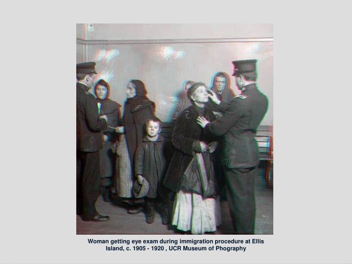 Woman getting eye exam during immigration procedure at Ellis Island, c. 1905 - 1920