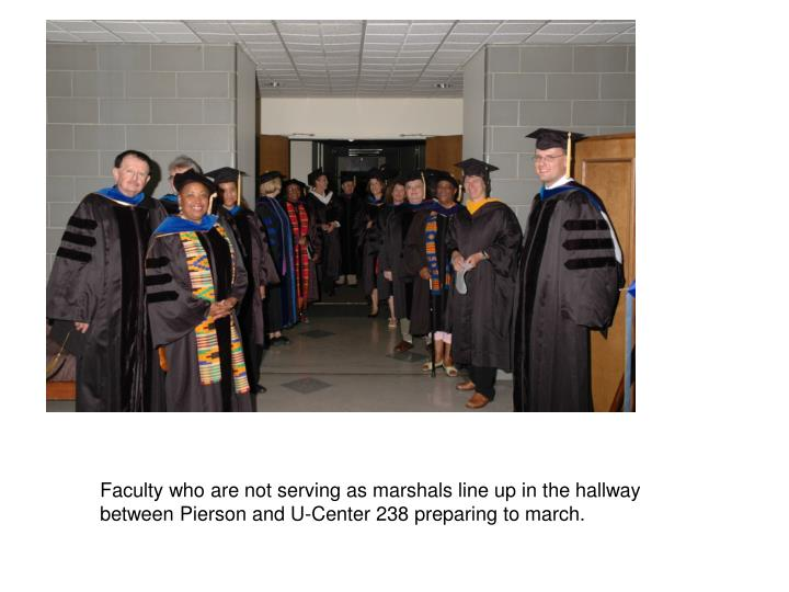Faculty who are not serving as marshals line up in the hallway between Pierson and U-Center 238 preparing to march.