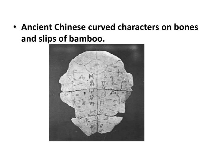 Ancient Chinese curved characters on bones and slips of bamboo.
