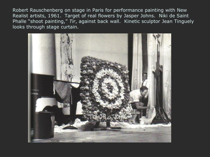 "Robert Rauschenberg on stage in Paris for performance painting with New Realist artists, 1961.  Target of real flowers by Jasper Johns.  Niki de Saint Phalle ""shoot painting,"""