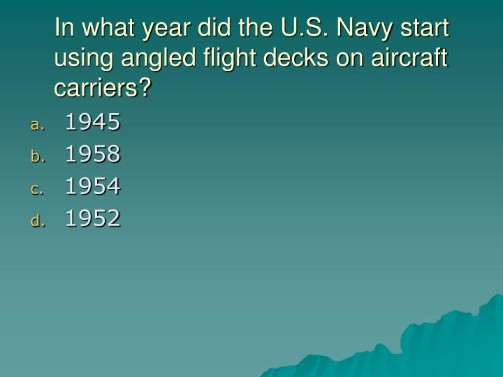 In what year did the U.S. Navy start using angled flight decks on aircraft carriers?