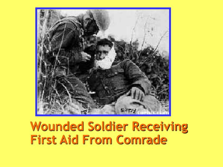 Wounded Soldier Receiving First Aid From Comrade