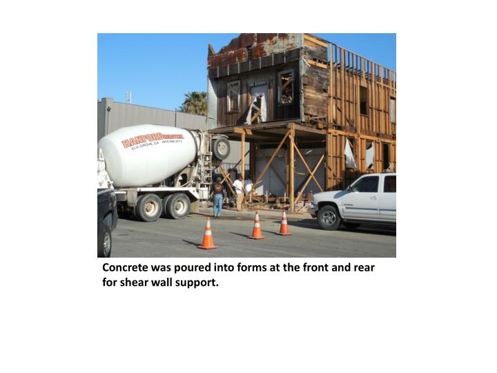 Concrete was poured into forms at the front and rear for shear wall support.