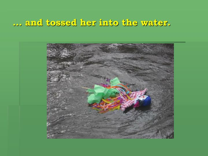 … and tossed her into the water.