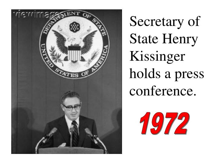 Secretary of State Henry Kissinger holds a press conference.