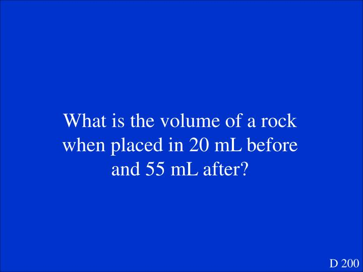 What is the volume of a rock when placed in 20