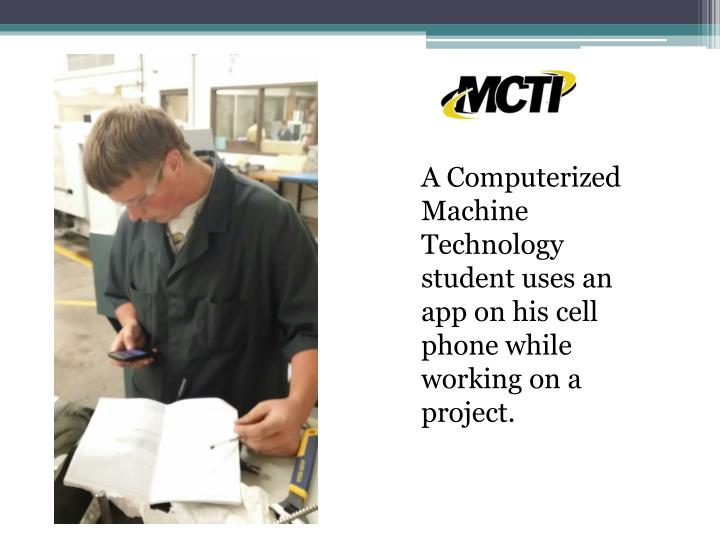 A Computerized Machine Technology student uses an app on his cell phone while working on a project.