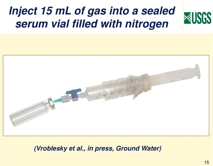 Inject 15 mL of gas into a sealed serum vial filled with nitrogen