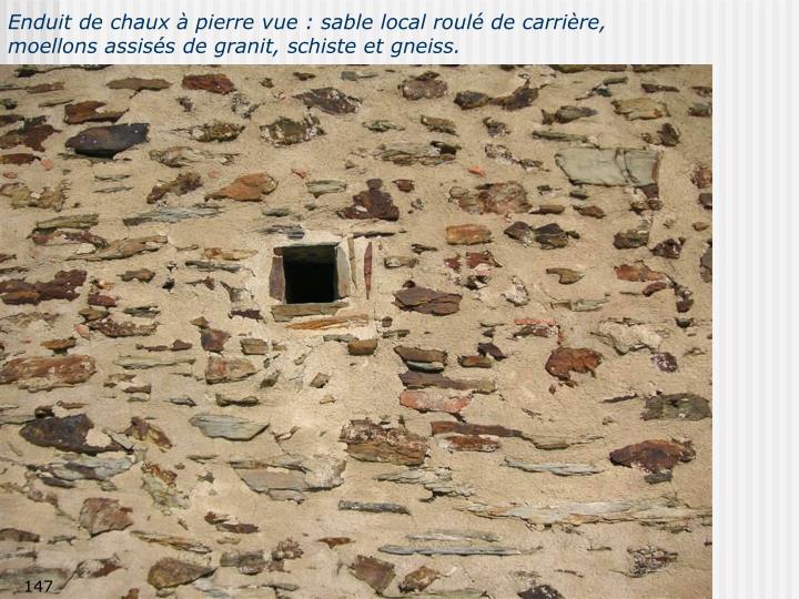 Enduit de chaux à pierre vue : sable local roulé de carrière,