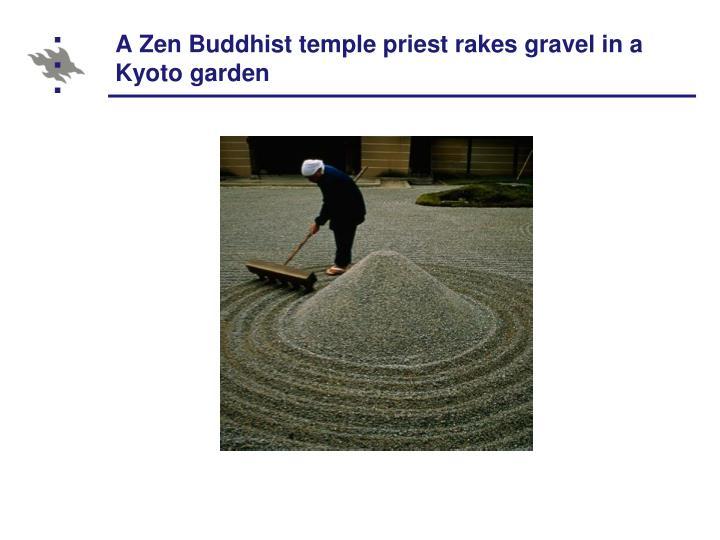 A Zen Buddhist temple priest rakes gravel in a Kyoto garden