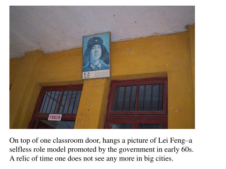 On top of one classroom door, hangs a picture of Lei Feng–a