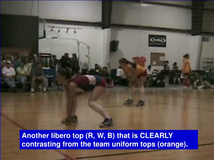 Another libero top (R, W, B) that is CLEARLY contrasting from the team uniform tops (orange).
