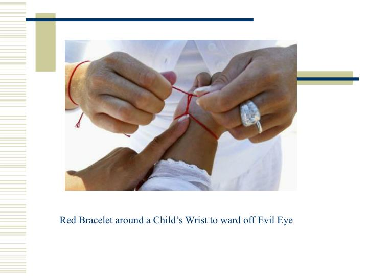 Red Bracelet around a Child's Wrist to ward off Evil Eye