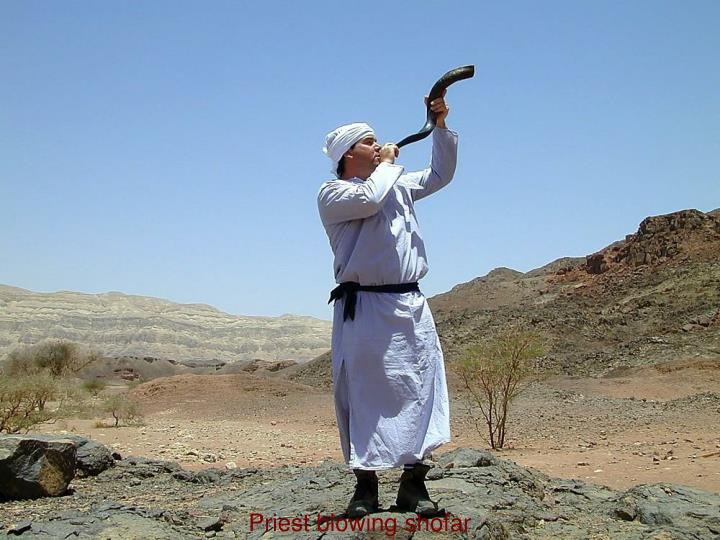 Priest blowing shofar