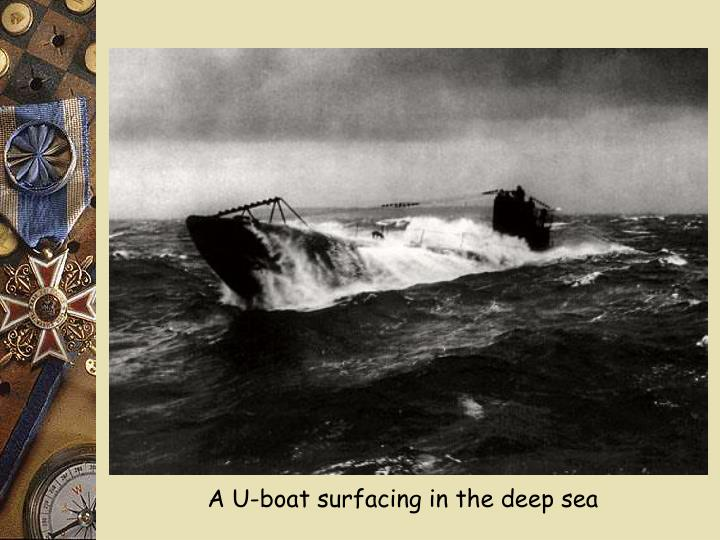 A U-boat surfacing in the deep sea