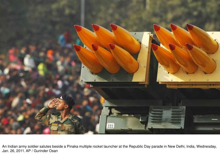 An Indian army soldier salutes beside a Pinaka multiple rocket launcher at the Republic Day parade in New Delhi, India, Wednesday, Jan. 26, 2011. AP / Gurinder Osan