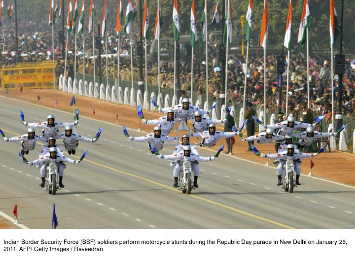 Indian Border Security Force (BSF) soldiers perform motorcycle stunts during the Republic Day parade in New Delhi on January 26, 2011. AFP/ Getty Images / Raveedran