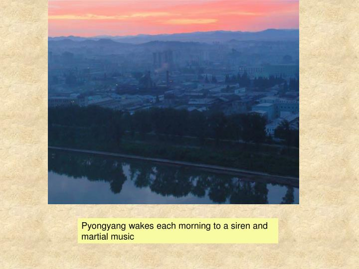Pyongyang wakes each morning to a siren and martial music