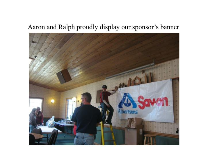 Aaron and ralph proudly display our sponsor s banner