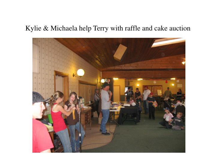Kylie & Michaela help Terry with raffle and cake auction