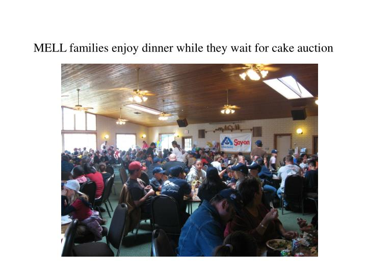 MELL families enjoy dinner while they wait for cake auction