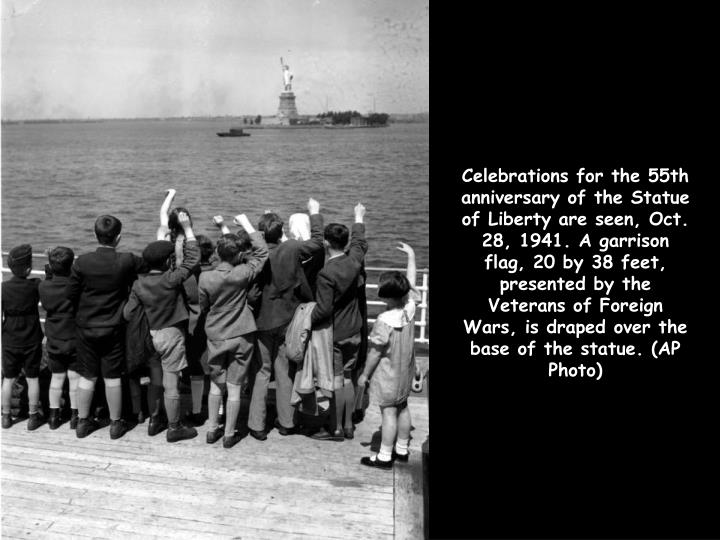 Celebrations for the 55th anniversary of the Statue of Liberty are seen, Oct. 28, 1941. A garrison flag, 20 by 38 feet, presented by the Veterans of Foreign Wars, is draped over the base of the statue. (AP Photo)