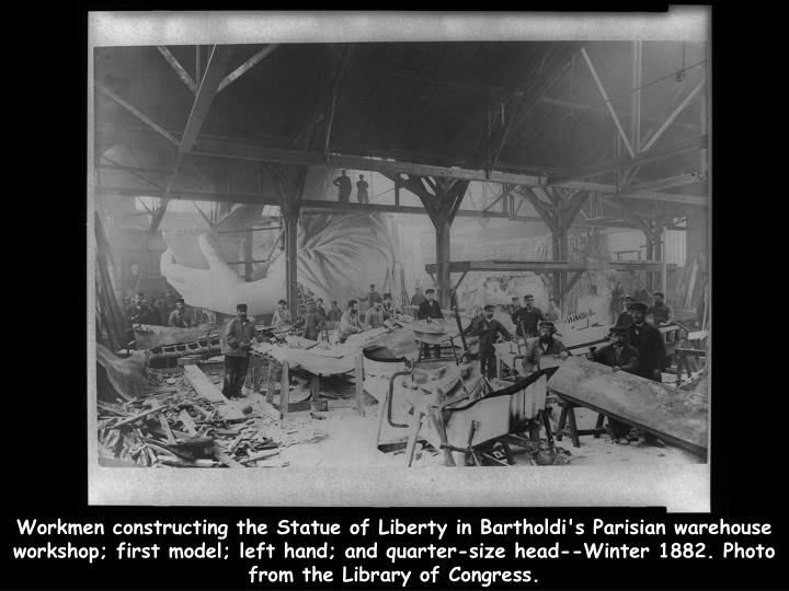 Workmen constructing the Statue of Liberty in Bartholdi's Parisian warehouse workshop; first model; left hand; and quarter-size head--Winter 1882. Photo from the Library of Congress.