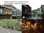 traditional style inns souvenir shops river bridges visitors in kimono
