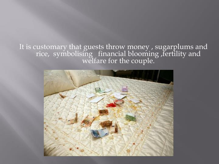 It is customary that guests throw money , sugarplums and  rice,