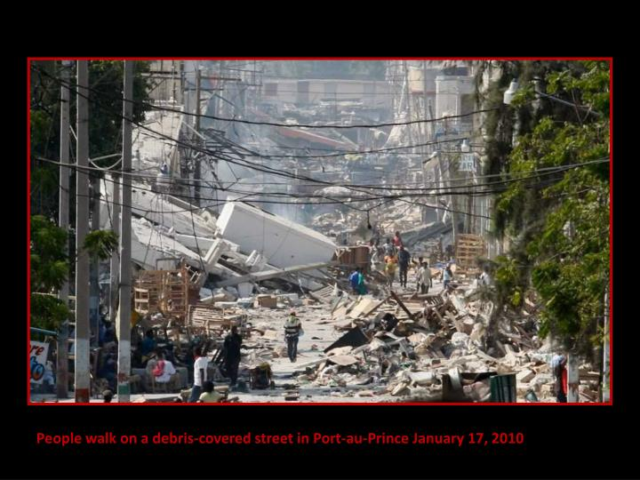 People walk on a debris-covered street in Port-au-Prince January 17, 2010