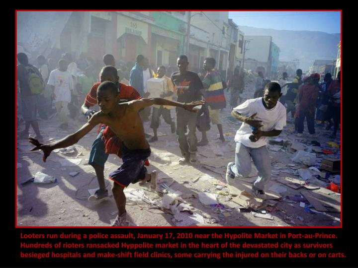 Looters run during a police assault, January 17, 2010 near the Hypolite Market in Port-au-Prince.