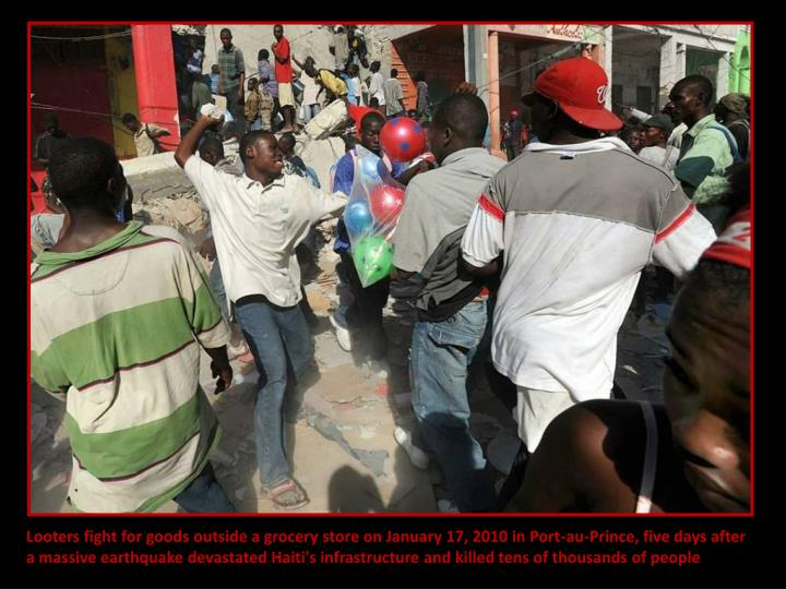 Looters fight for goods outside a grocery store on January 17, 2010 in Port-au-Prince, five days after