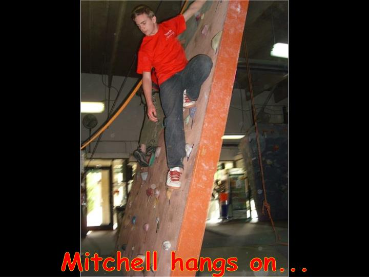 Mitchell hangs on...