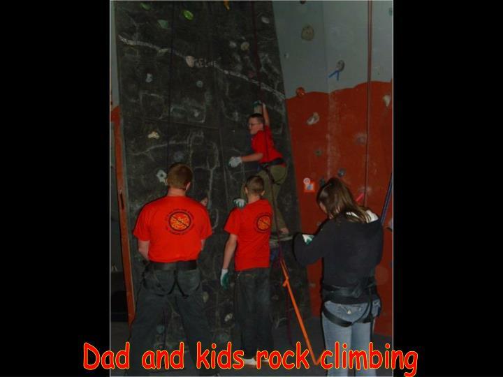 Dad and kids rock climbing