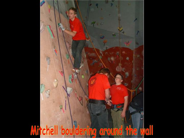 Mitchell bouldering around the wall