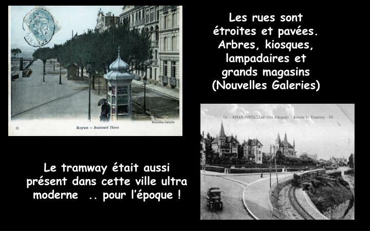 Les rues sont  étroites et pavées. Arbres, kiosques, lampadaires et grands magasins (Nouvelles Galeries)