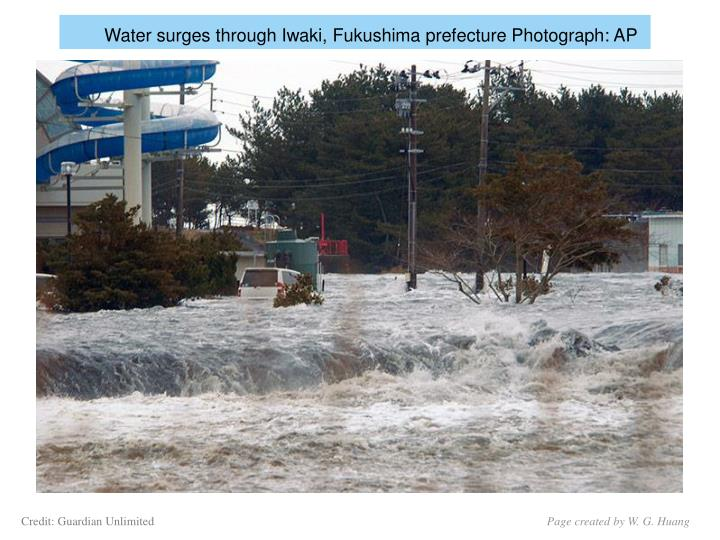 Water surges through Iwaki, Fukushima prefecture Photograph: AP