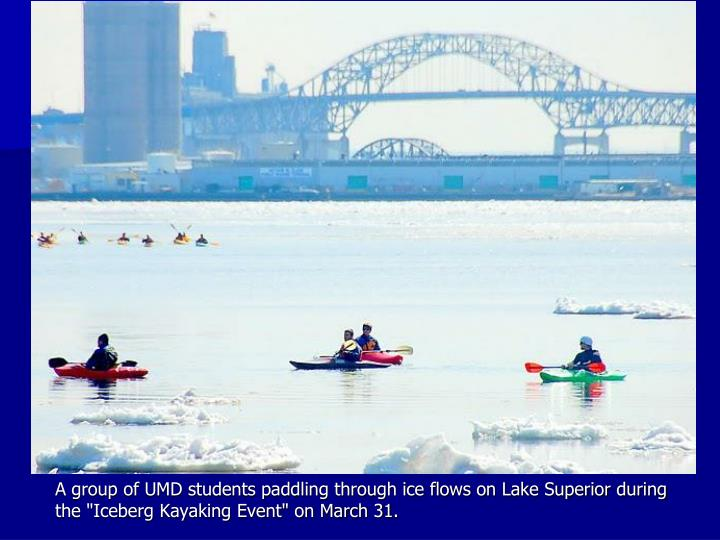 "A group of UMD students paddling through ice flows on Lake Superior during the ""Iceberg Kayaking Event"" on March 31."