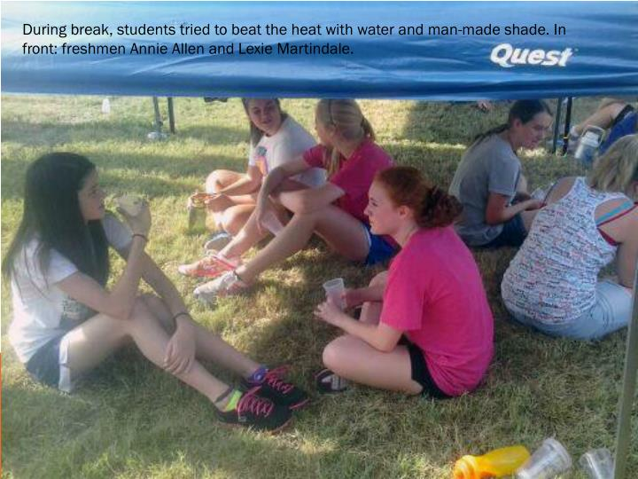 During break, students tried to beat the heat with water and man-made shade. In front