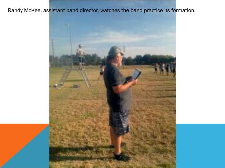 Randy McKee, assistant band director, watches the band practice its formation.