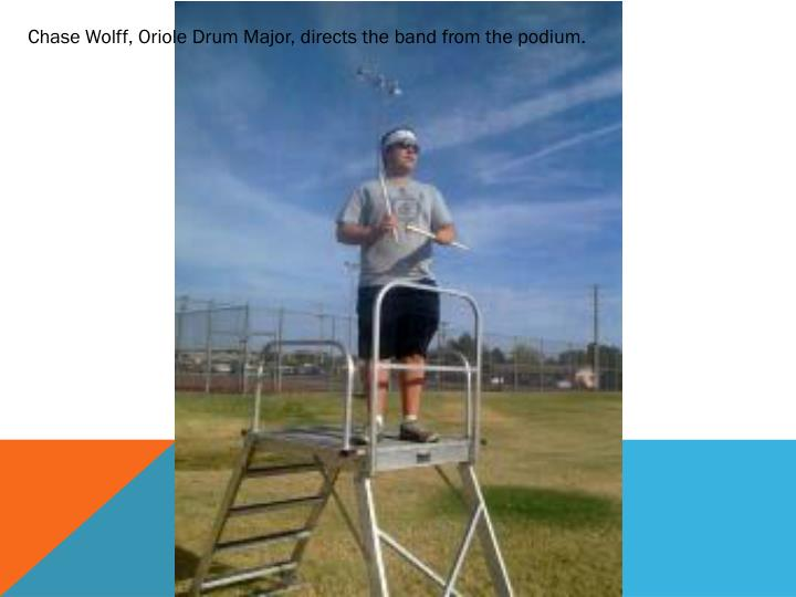 Chase Wolff, Oriole Drum Major, directs the band from the podium.