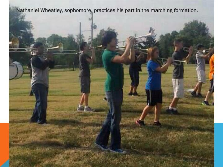 Nathaniel Wheatley, sophomore, practices his part in the marching formation.